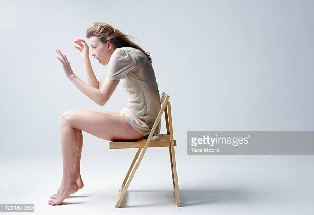 woman sitting on chair being blown by wind