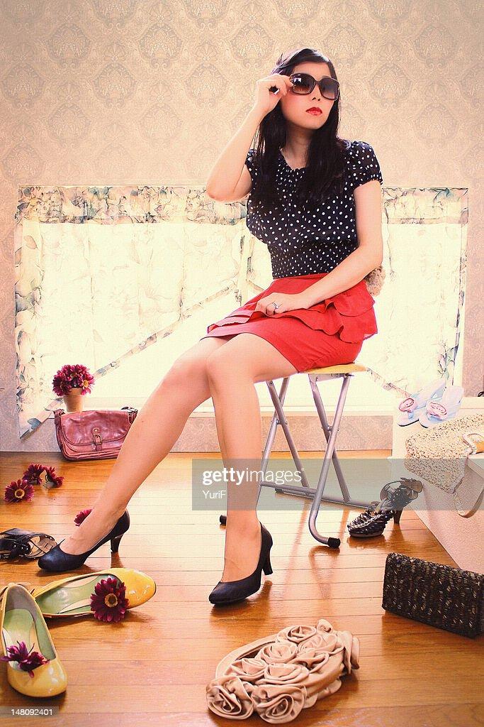 Woman sitting on chair : Stockfoto