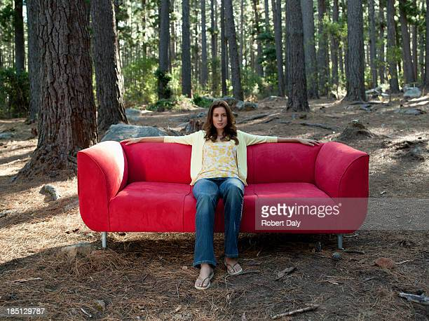a woman sitting on coach outdoors in the woods - out of context stock pictures, royalty-free photos & images