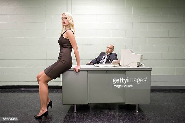 Woman sitting on detectives desk