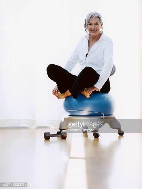 Woman Sitting on Fitness Ball