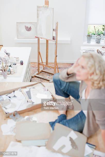 Woman sitting on floor of art studio