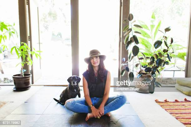 woman sitting on floor with her dog - sitting on ground stock pictures, royalty-free photos & images
