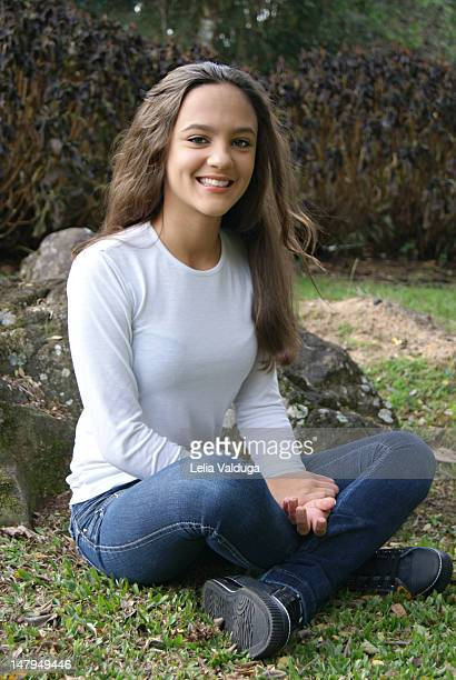 woman sitting on grass - 13 years old girl in jeans stock photos and pictures