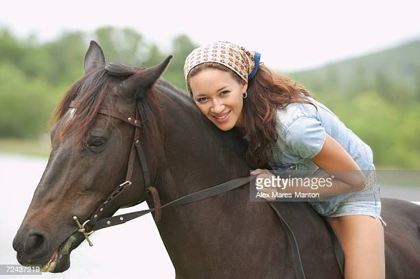 woman sitting on horse, leaning down, smiling - down blouse stock pictures, royalty-free photos & images