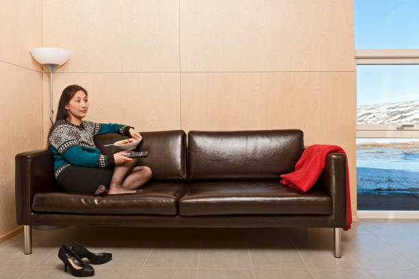 woman sitting on leather sofa inside of chalet in Iceland