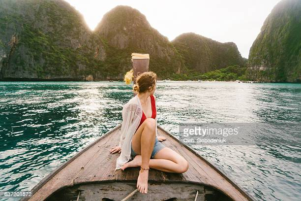Woman sitting on long tail boat