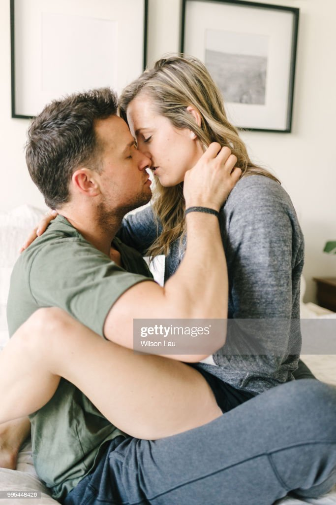 Woman Sitting On Mans Lap Kissing High Res Stock Photo Getty Images