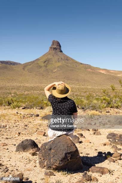 Woman sitting on Mojave desert