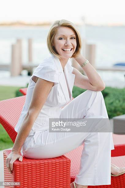 Woman sitting on patio furniture