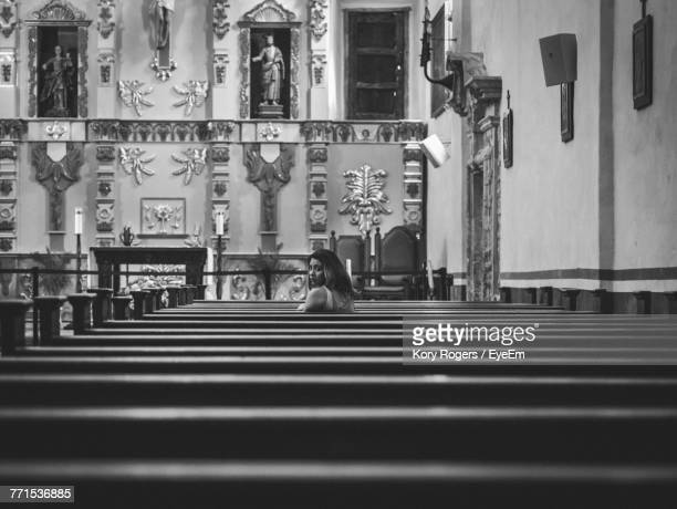 woman sitting on pew at church - faith rogers stock pictures, royalty-free photos & images