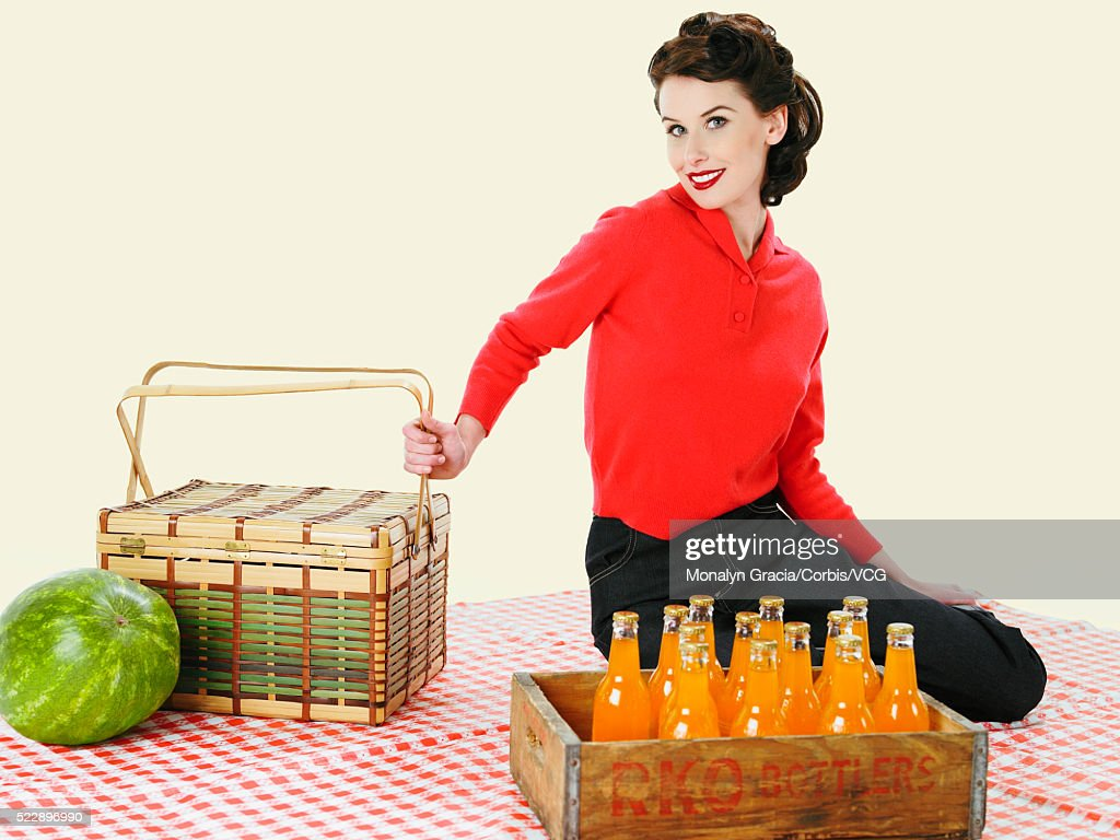 Woman Sitting On Picnic Blanket With Picnic Baskets Photo Getty Images