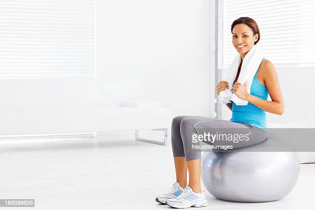 Woman Sitting on Pilates Ball