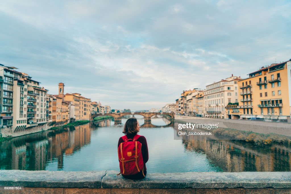 Woman sitting on Ponte Veccio and looking at view : Stock Photo