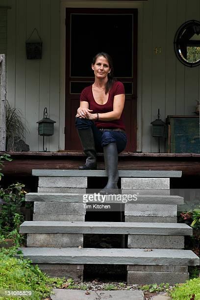Woman sitting on porch, portrait