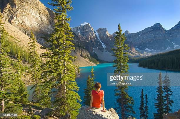 woman sitting on rock at Lake Moraine