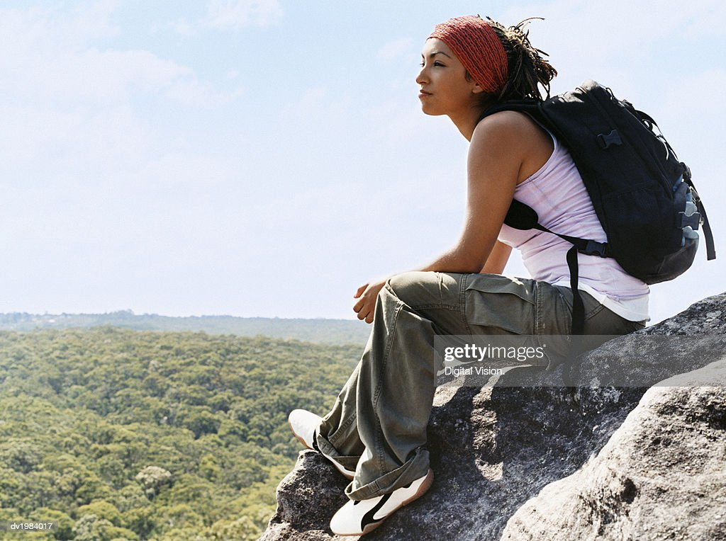 Woman Sitting on Rock Looking at View : Stock Photo