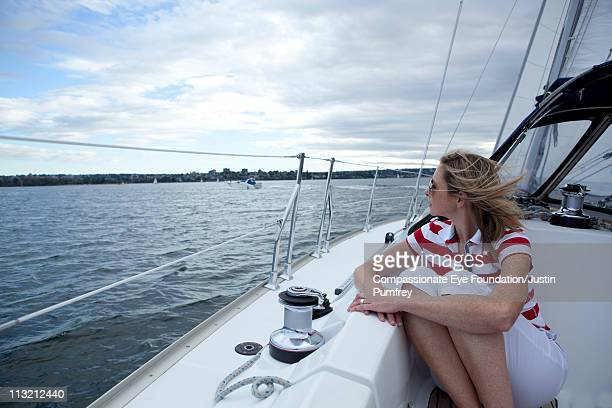 "woman sitting on sailboat - ""compassionate eye"" stock pictures, royalty-free photos & images"