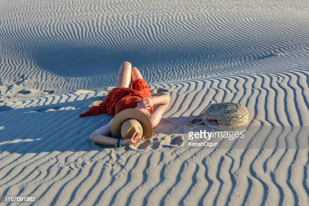 woman sitting on sands. - kas stock pictures, royalty-free photos & images