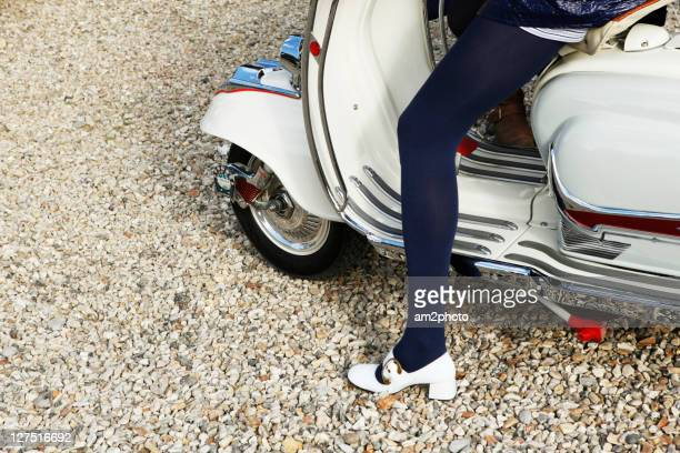 Woman sitting on scooter of sixties