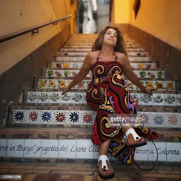 woman sitting on staircase - strapless evening gown stock pictures, royalty-free photos & images
