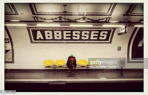 woman sitting on subway stop - subway station stock pictures, royalty-free photos & images