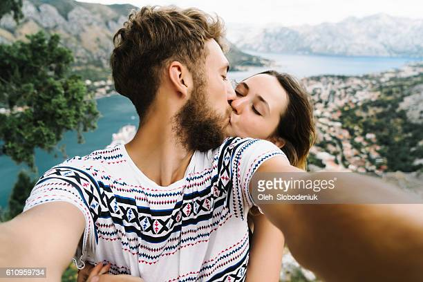 Woman sitting on the background of Kotor