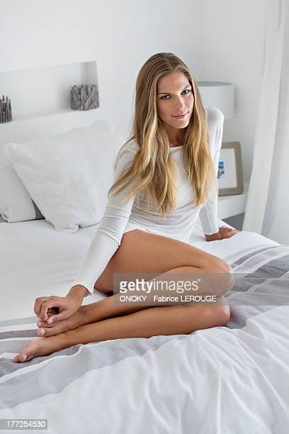 Woman sitting on the bed