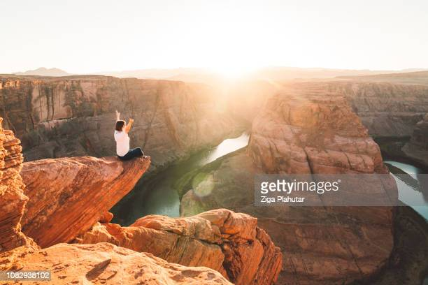 woman sitting on the edge - sandstone stock pictures, royalty-free photos & images