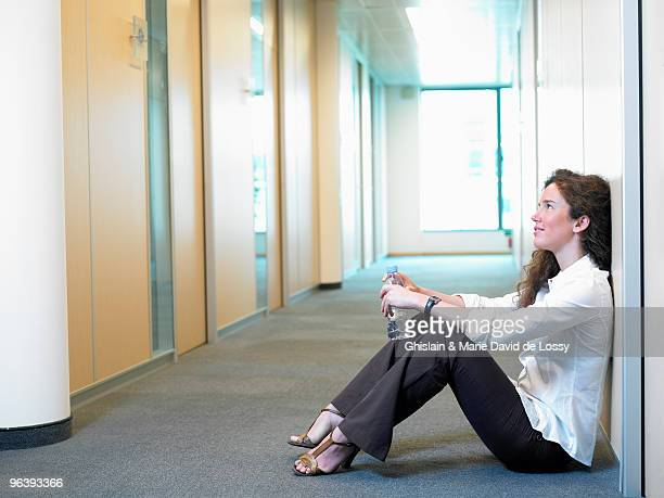 Woman sitting on the floor, at work
