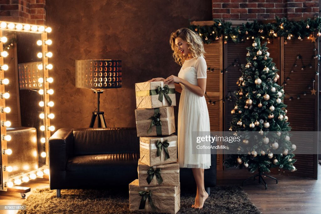 Woman sitting on the floor new year's eve : Stock Photo
