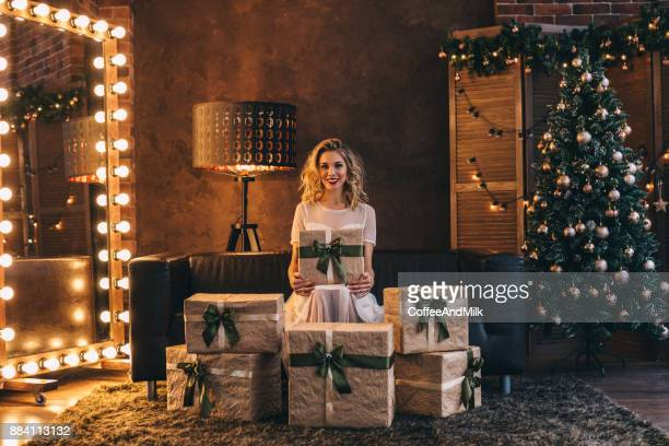 woman sitting on the floor new year's eve - happy new month stock photos and pictures