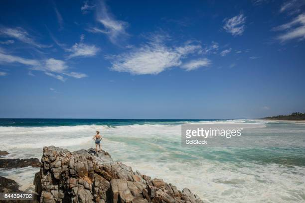 Woman Sitting on the Rock Edge at Noosa Heads