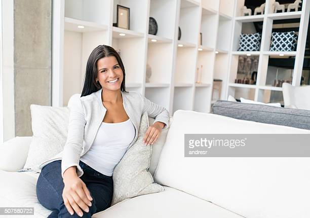 Woman sitting on the sofa at a furniture store