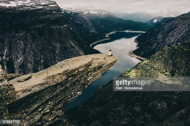 Woman sitting on Trolltunga