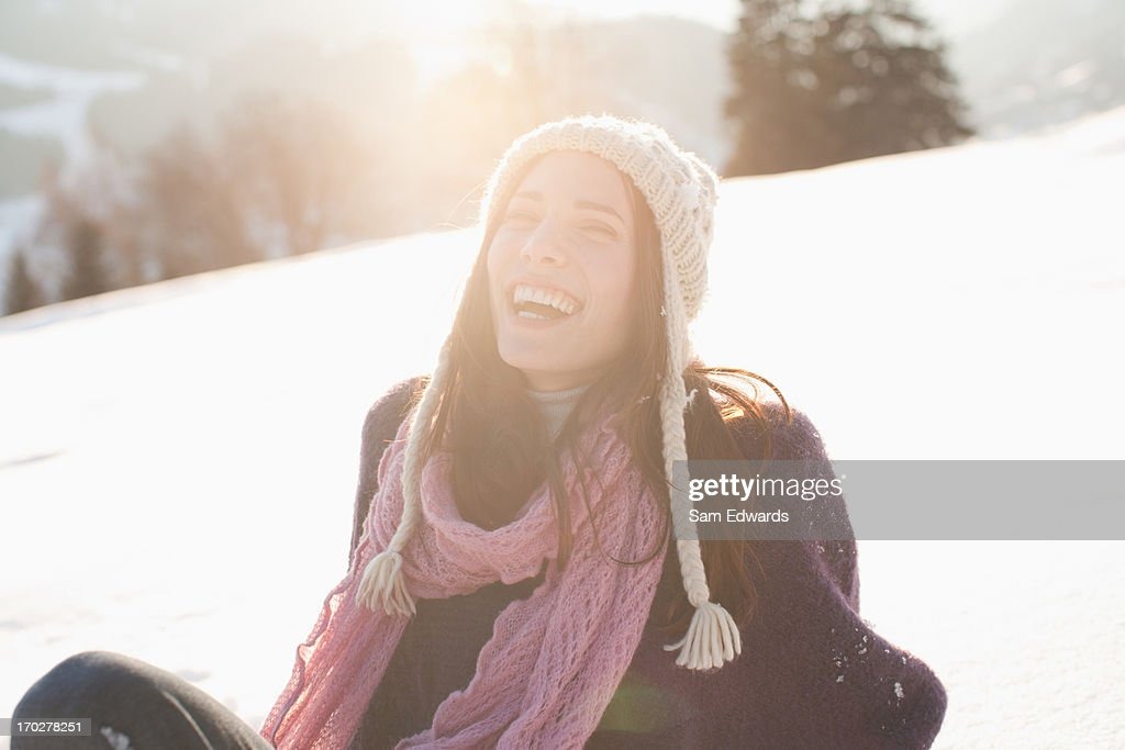 Woman sitting outdoors in snow : Stock Photo