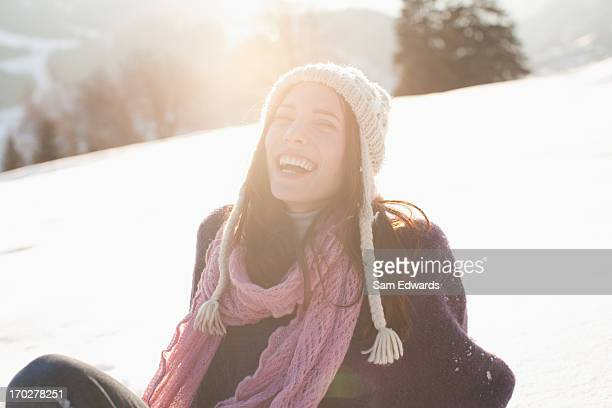 woman sitting outdoors in snow - light natural phenomenon stock pictures, royalty-free photos & images