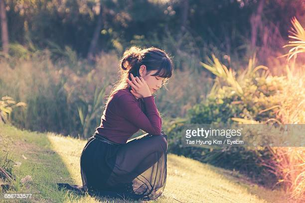 woman sitting outdoors - kim tae hyung stock pictures, royalty-free photos & images