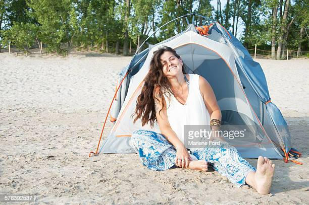 Woman sitting outside tent