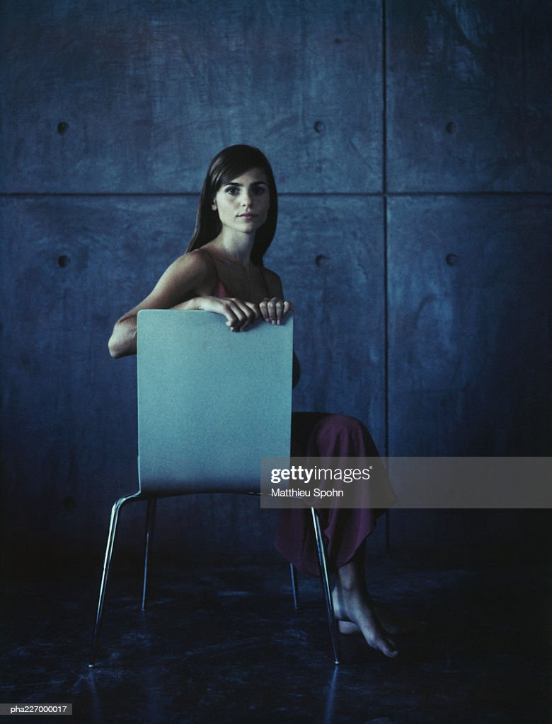 Woman sitting side saddle, looking into camera. : Stockfoto