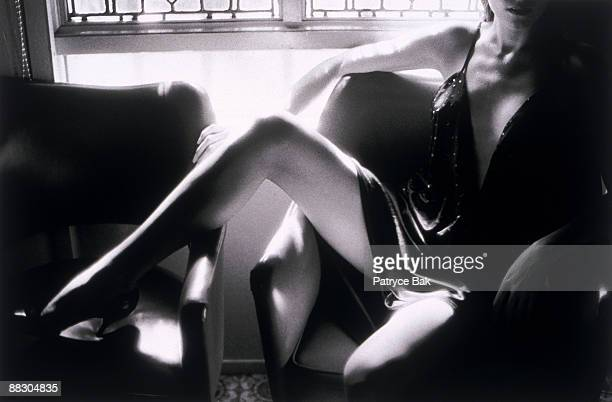 woman sitting spreading legs - woman leg spread stock photos and pictures