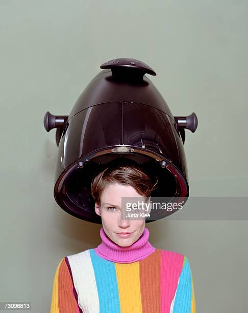 Woman sitting under a hair dryer in a hair salon