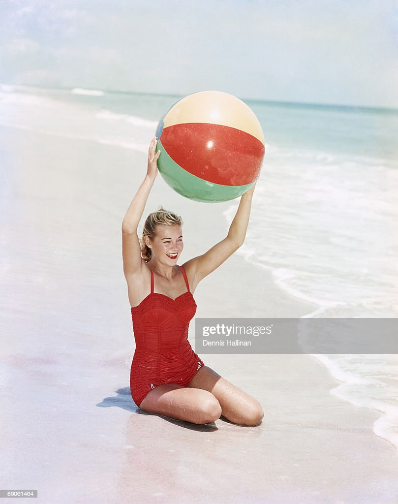 beach ball in ocean. Woman Sitting With Beach Ball By Ocean : Stock Photo In