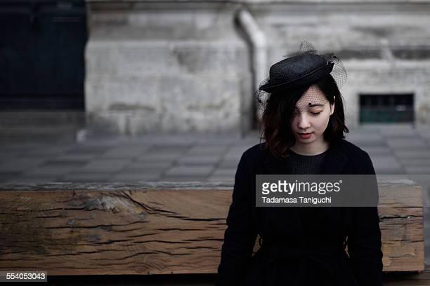 Woman sitting with black fashion