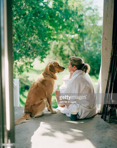 Woman sitting with dog