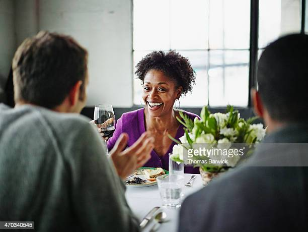 Woman sitting with friends at table during party