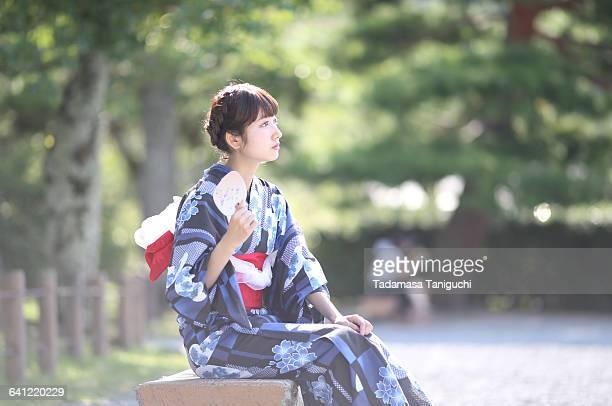 Woman sitting with japanese kimono