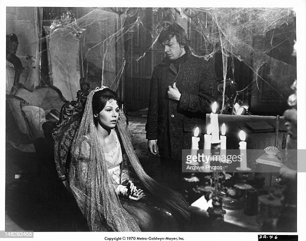 Woman sitting with John Karlen in the background in a scene from the film 'Night Of Dark Shadows' 1971