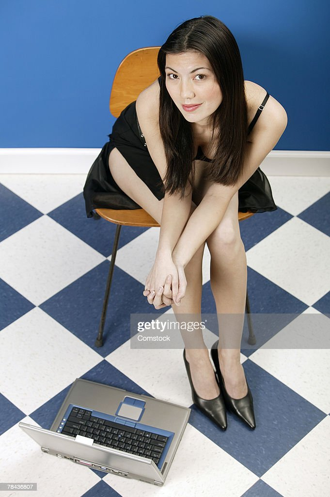 Woman sitting with laptop computer on the floor : Stock Photo
