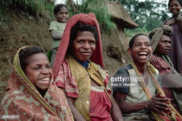 Woman Sitting With Laughing Boys